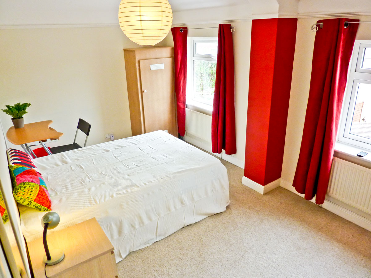 Bedroom 1, very large double room overlooking garden