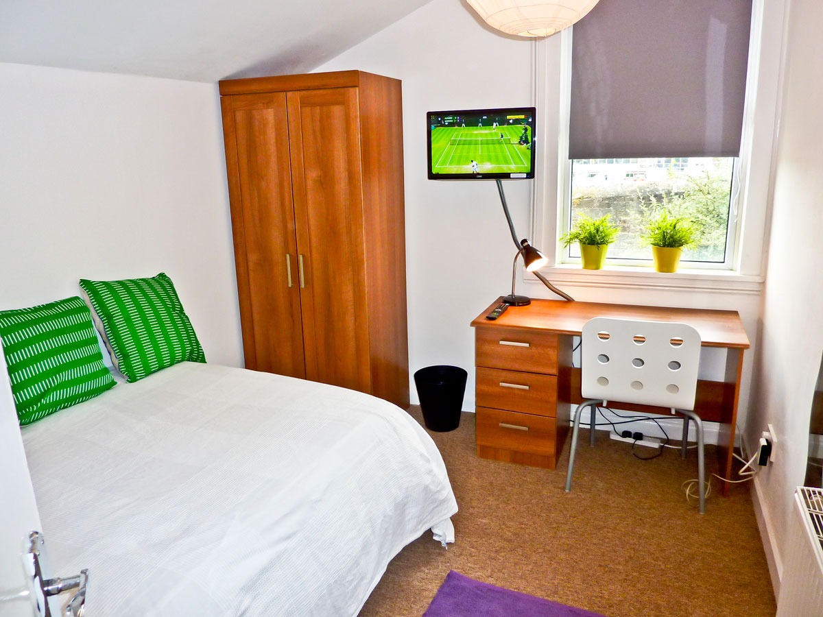 Bedroom 4, good size double room at rear overlooking garden